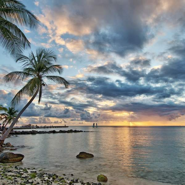 Admire the sunset at Marigot Bay