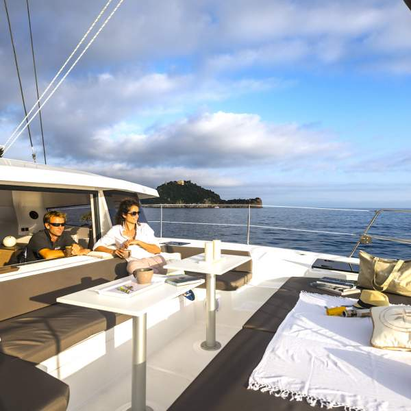 Relax at the front of the catamaran and catch the sunset