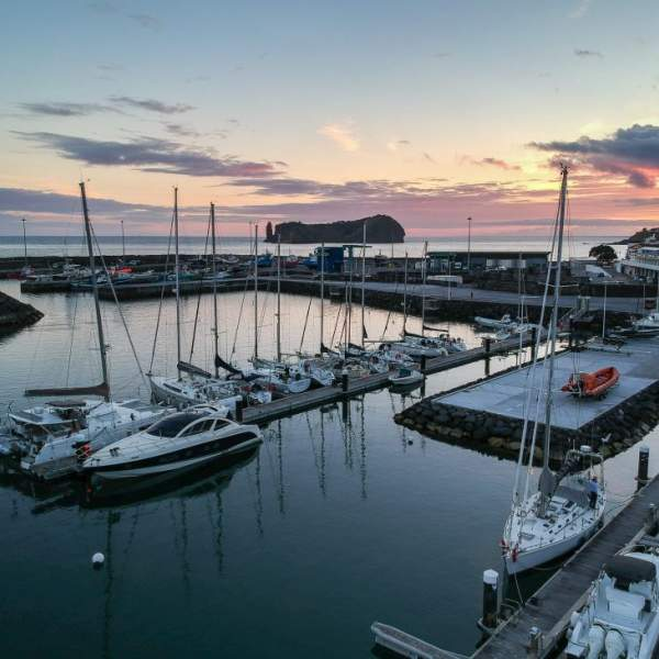 Admire the sunset from the marina of Vila Franca do Campo