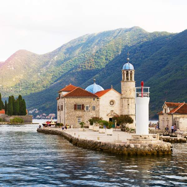 Admire Perast and the islet Notre-Dame du Rocher