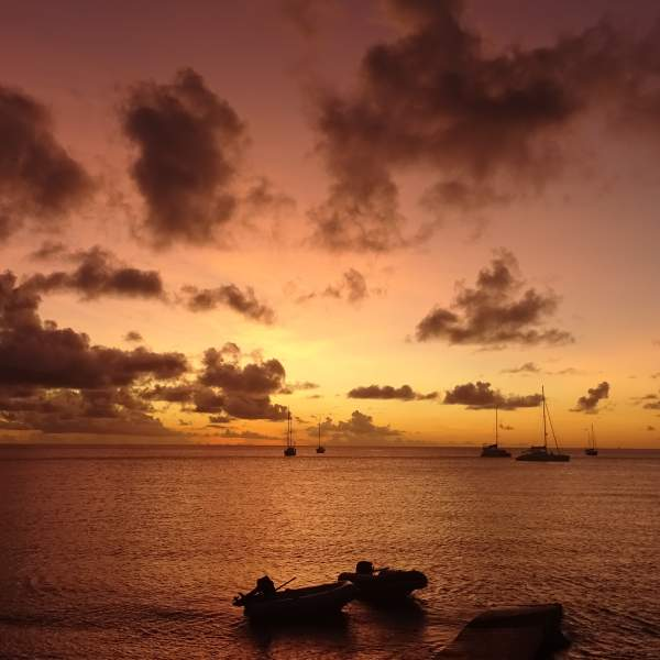 Admire the beauty of the Caribbean sunsets