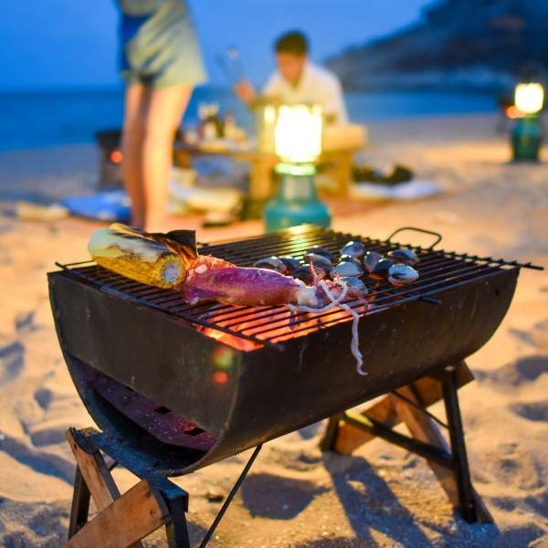 Relax on the beach with a barbecue